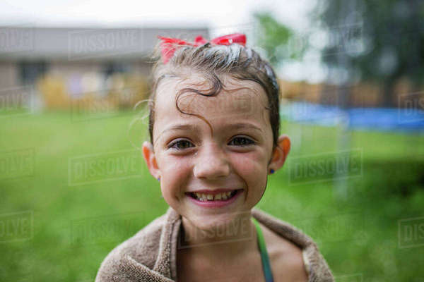 Portrait of happy girl wrapped in towel at yard Royalty-free stock photo