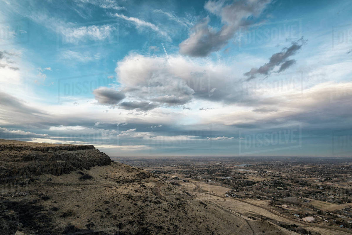 Scenic view of landscape against cloudy sky at Denver - Scenic View Of Landscape Against Cloudy Sky At Denver - Stock Photo