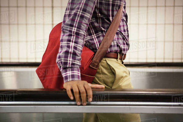 Young man on moving walkway Royalty-free stock photo