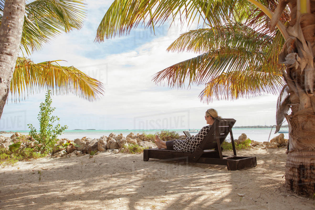 Awesome Woman Resting On Lounge Chair At Beach D1061 1 686 Ocoug Best Dining Table And Chair Ideas Images Ocougorg