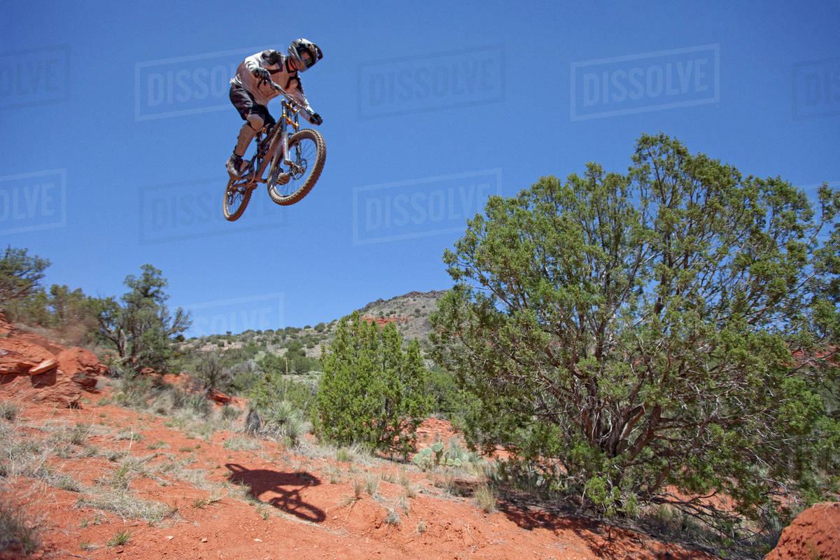 Mountain biker performing jump Royalty-free stock photo