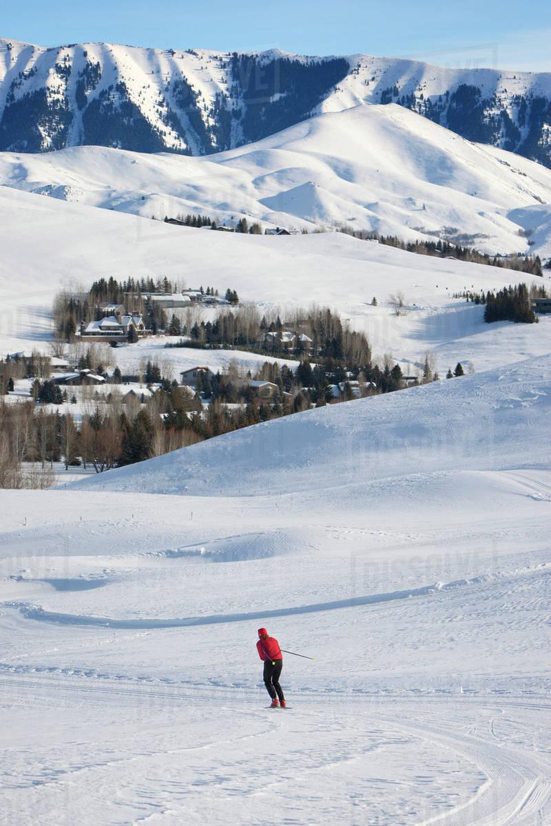 Woman skiing down mountain slope Royalty-free stock photo