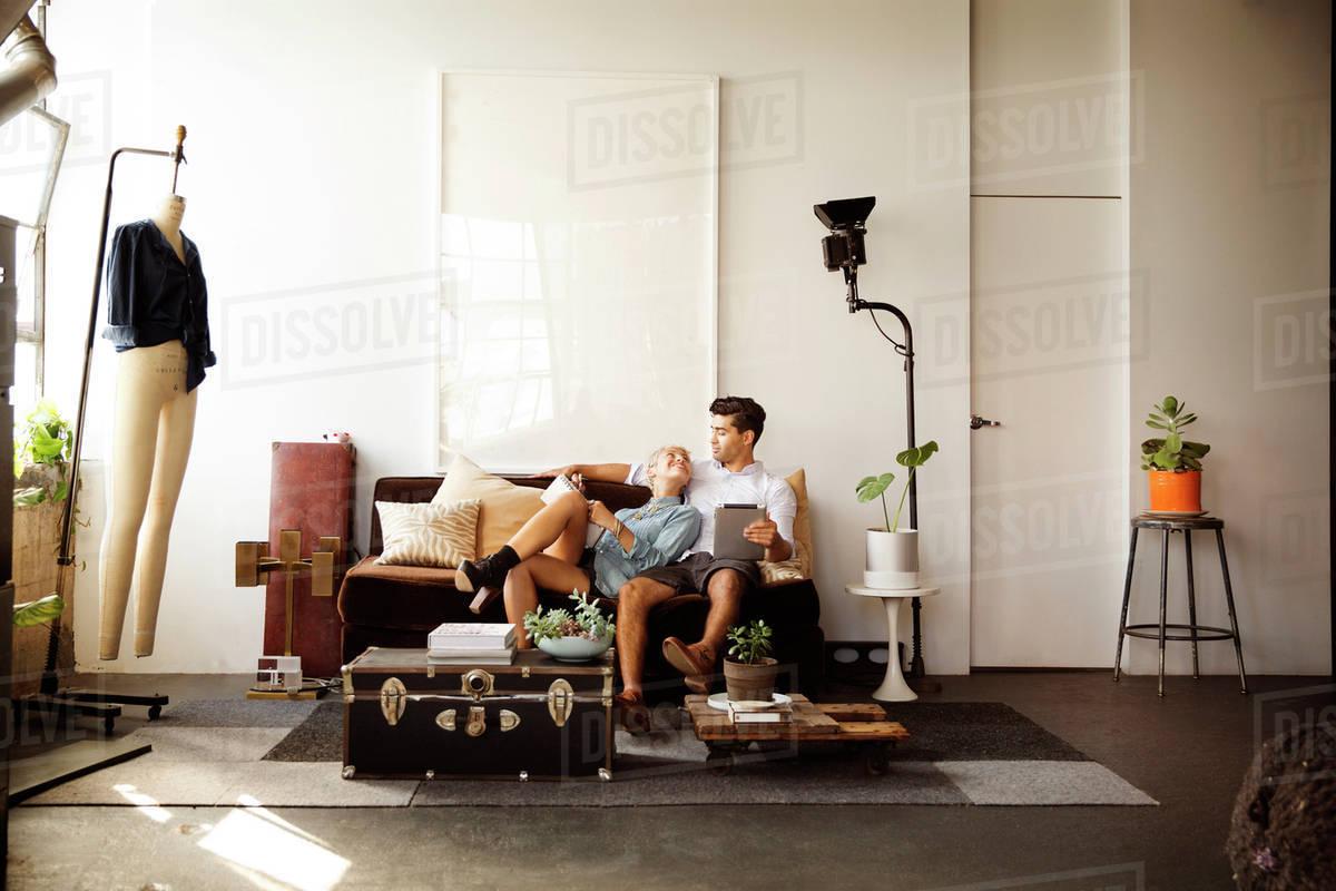 Couple sitting on sofa Royalty-free stock photo