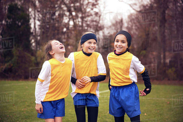 Girls (8-9,  10-11) from soccer team laughing together Royalty-free stock photo