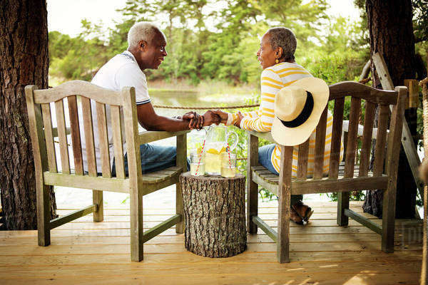 Senior couple face to face on porch Royalty-free stock photo