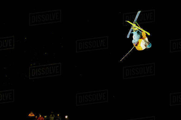 Skier doing trick at night Royalty-free stock photo