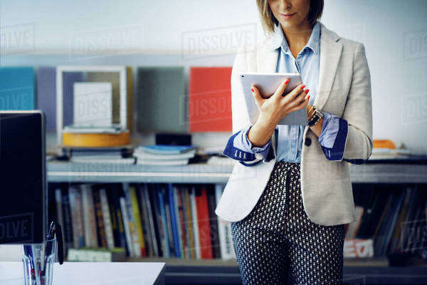 Woman using digital tablet at office Royalty-free stock photo