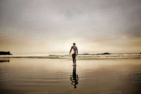 Male surfer walking on beach Royalty-free stock photo