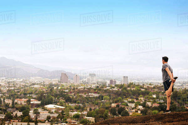 USA, California, Los Angeles, Man exercising and looking at cityscape Royalty-free stock photo