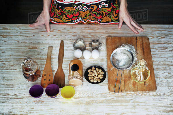 Midsection of woman standing by food on wooden table Royalty-free stock photo