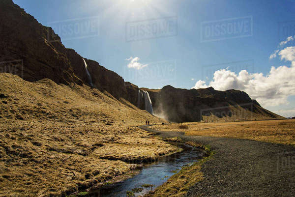 Scenic view of waterfalls and field against sky Royalty-free stock photo