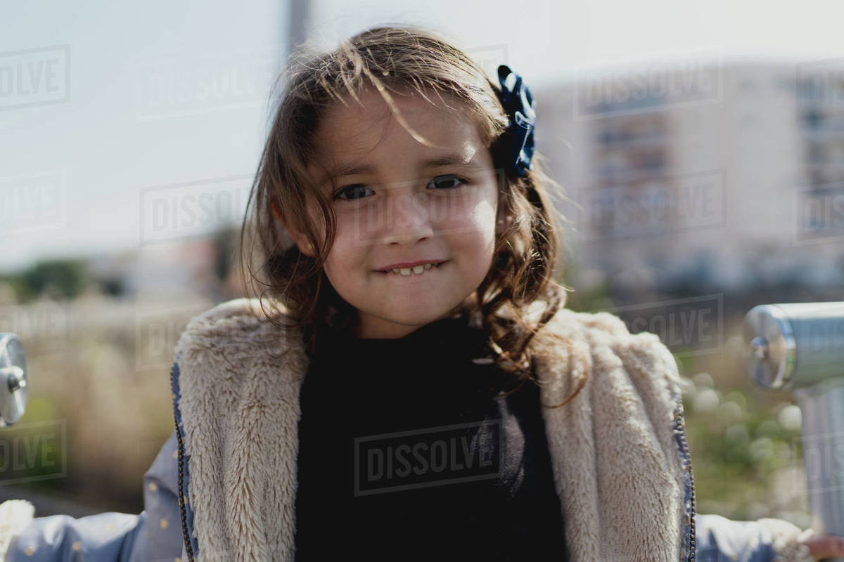 Portrait of a four-year-old girl smiling in a park by day Royalty-free stock photo