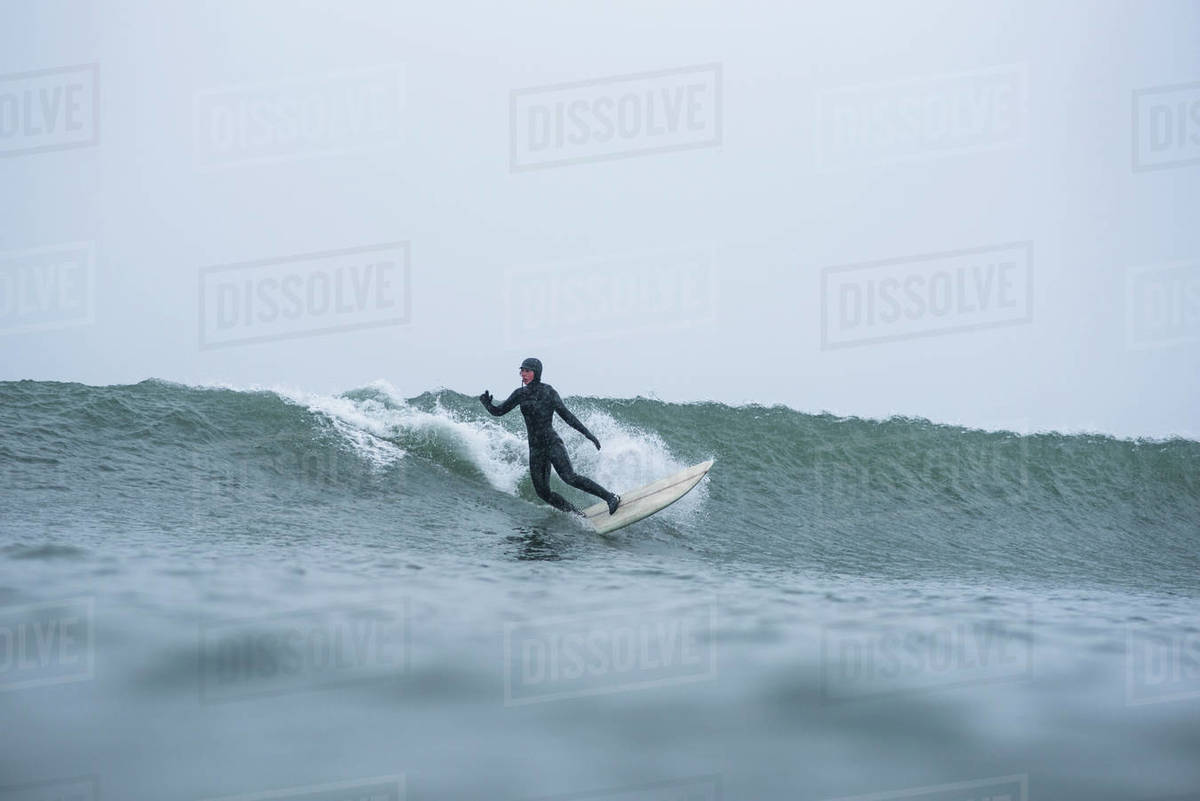 Woman surfing during winter snow Royalty-free stock photo