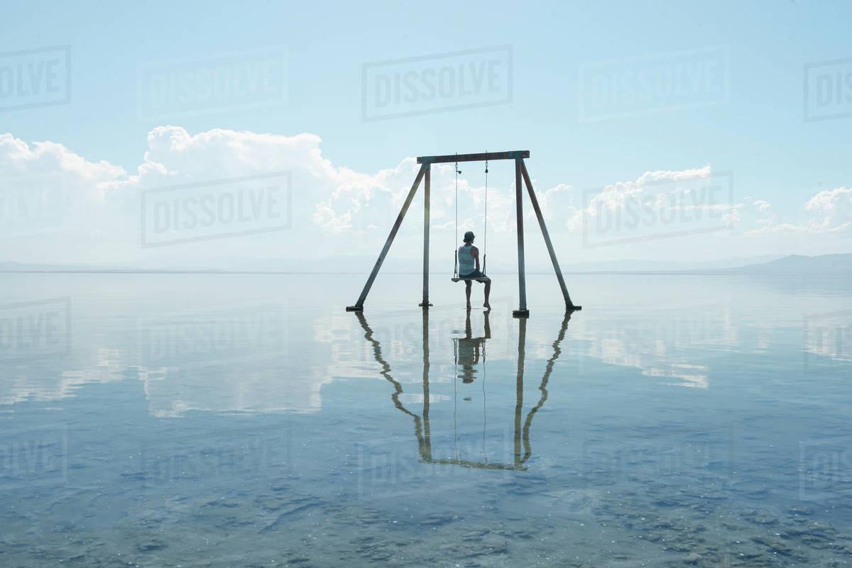 Self Portrait on Swing Set in Reflection on Salton Sea Californi Royalty-free stock photo