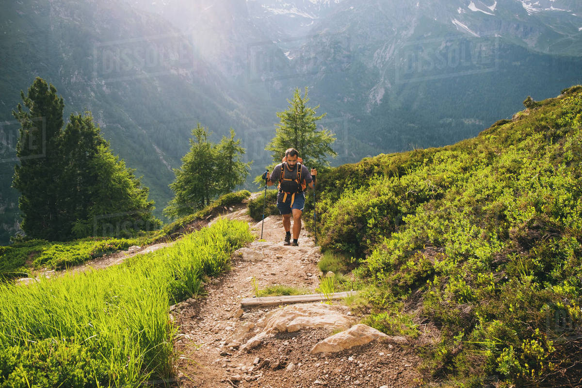 Man hiker going up to Aiguillette des Posettes, French Alps, Chamonix Royalty-free stock photo