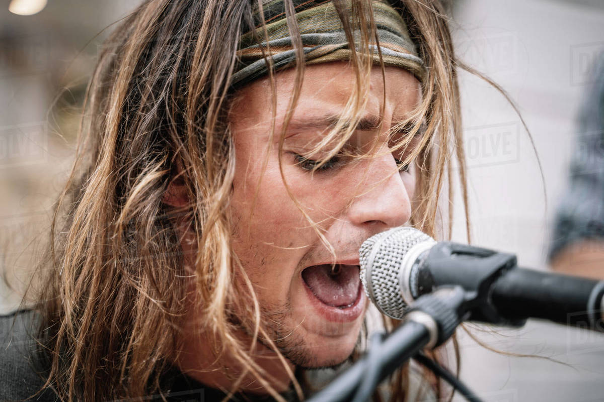 Face of a young rocker singing in the street Royalty-free stock photo