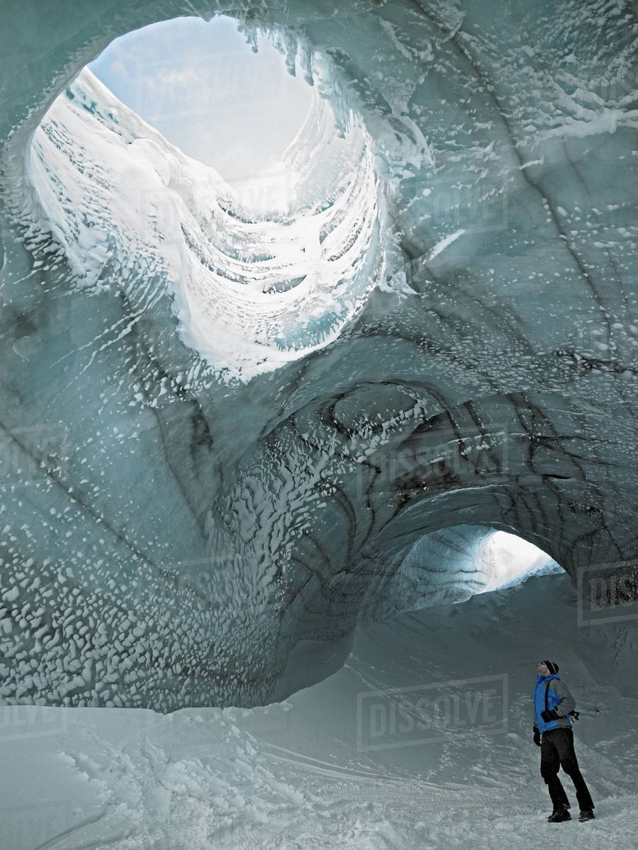 Man exploring ice cave in Iceland Royalty-free stock photo
