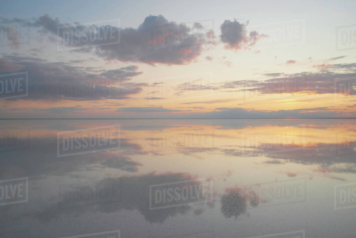 Lake Elton, tranquility scene with mirrored warm tone cloudscape Royalty-free stock photo