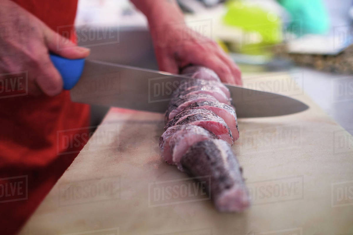 Raw fish caught in the hand of the fisherman Royalty-free stock photo