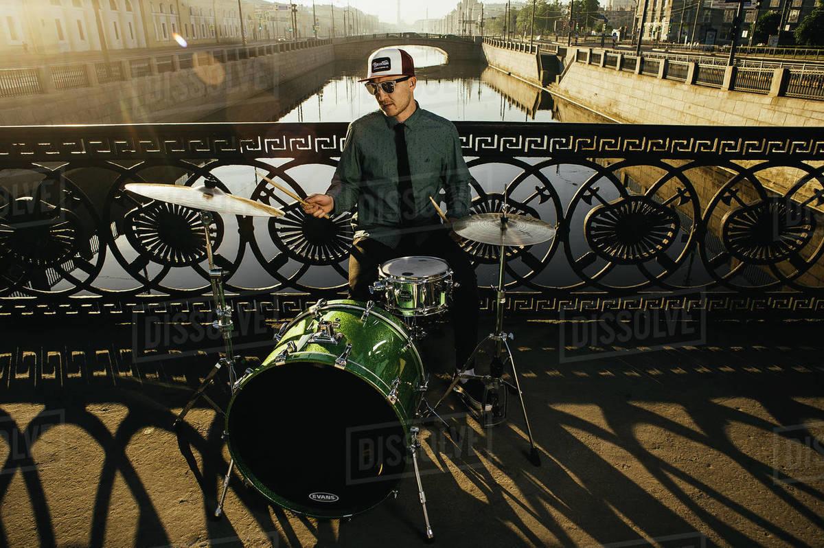 Drum Player at River Bridge Royalty-free stock photo
