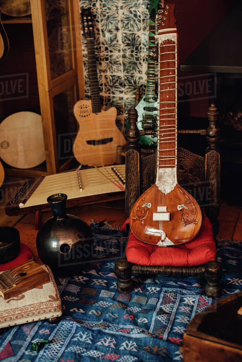 A group of traditional musical instruments: sitar, kalimba, guitar Royalty-free stock photo