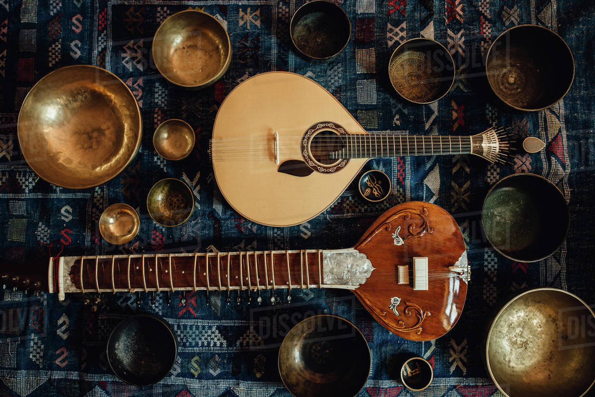 Traditional instruments: sitar and portuguese guitar and singing bowls Royalty-free stock photo
