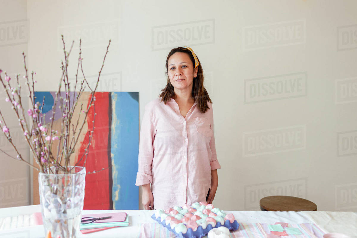 Portrait of woman in pink shirt by craft art table Royalty-free stock photo