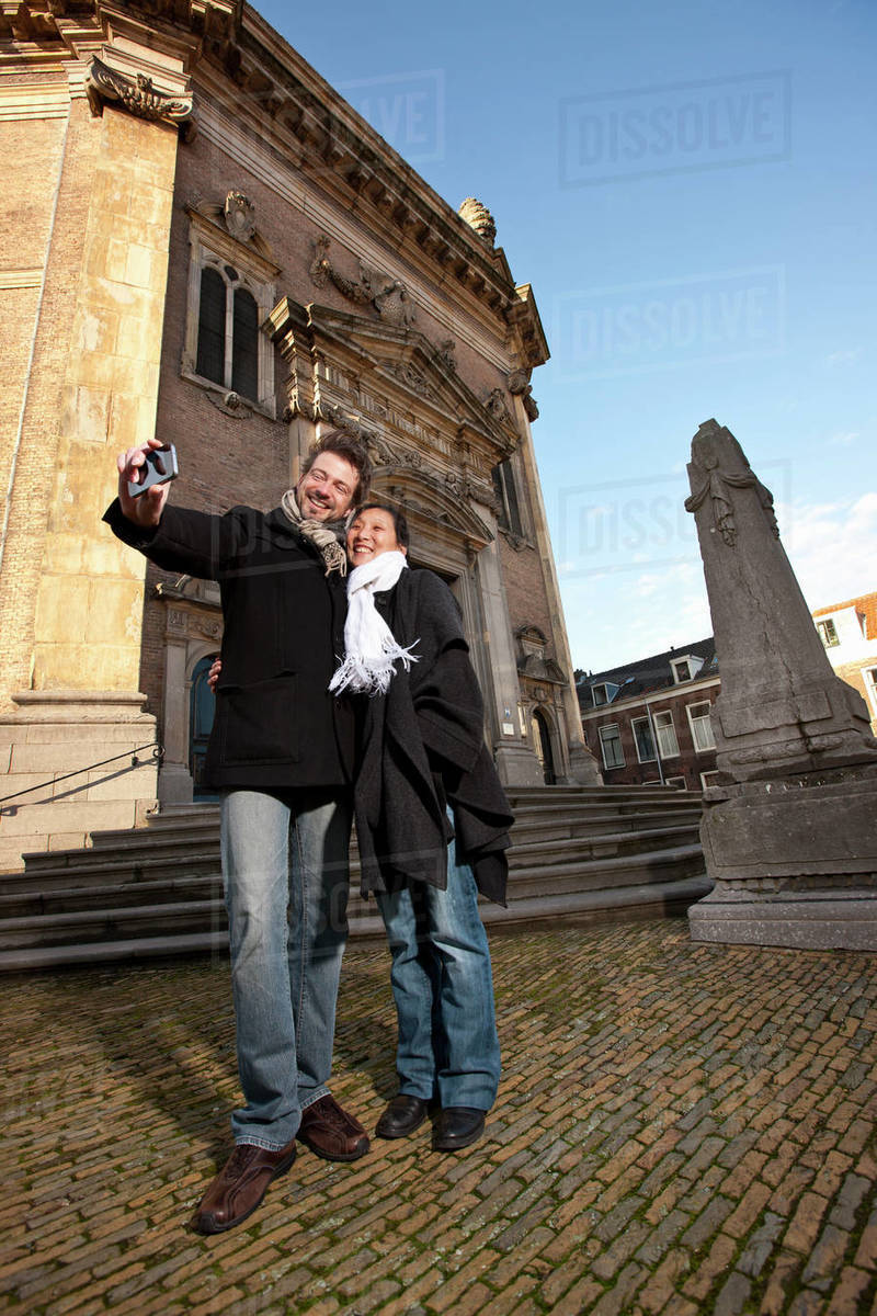 Mature couple taking selfie in the town centre of Middelburgf Royalty-free stock photo