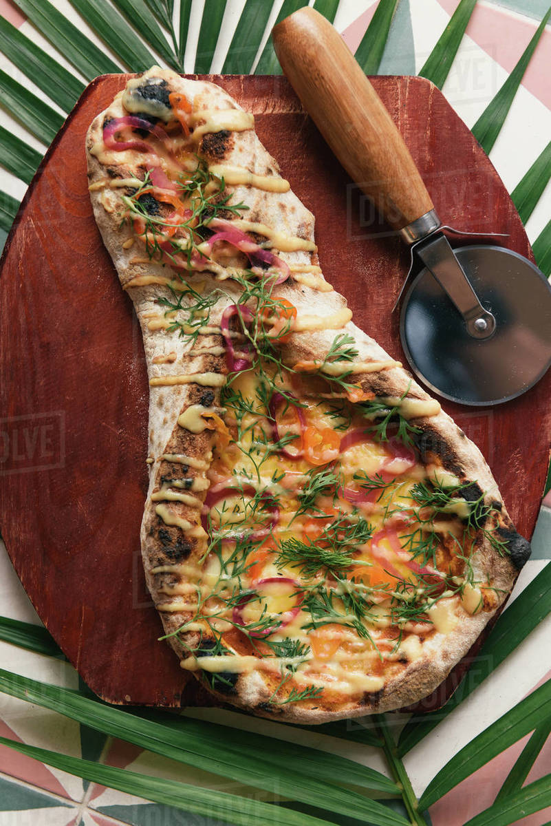 Ecuadorian wood-fired flatbread with fresh vegetables from overhead Royalty-free stock photo