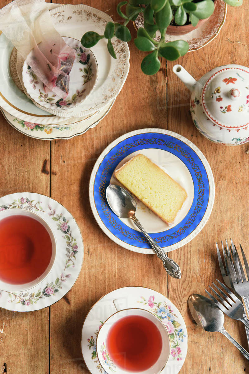 Overhead of tea time at a cafe with cake and teapots Royalty-free stock photo