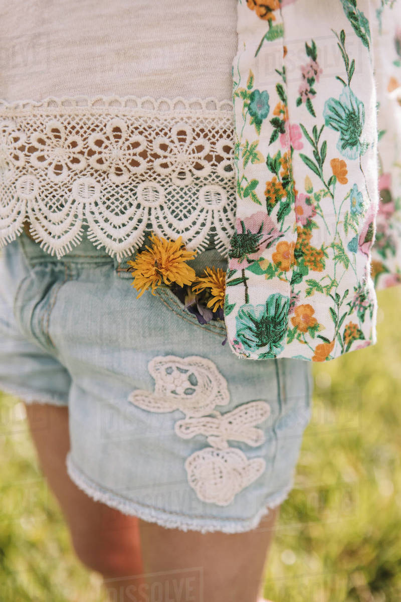 Dandelions plucked and put in a three year olds pocket Royalty-free stock photo