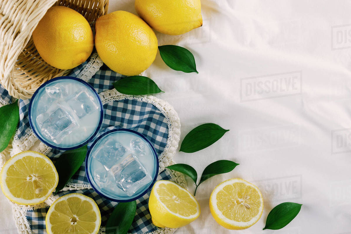 Top view of lemon juice glasses on a white tablecloth at a picnic Royalty-free stock photo