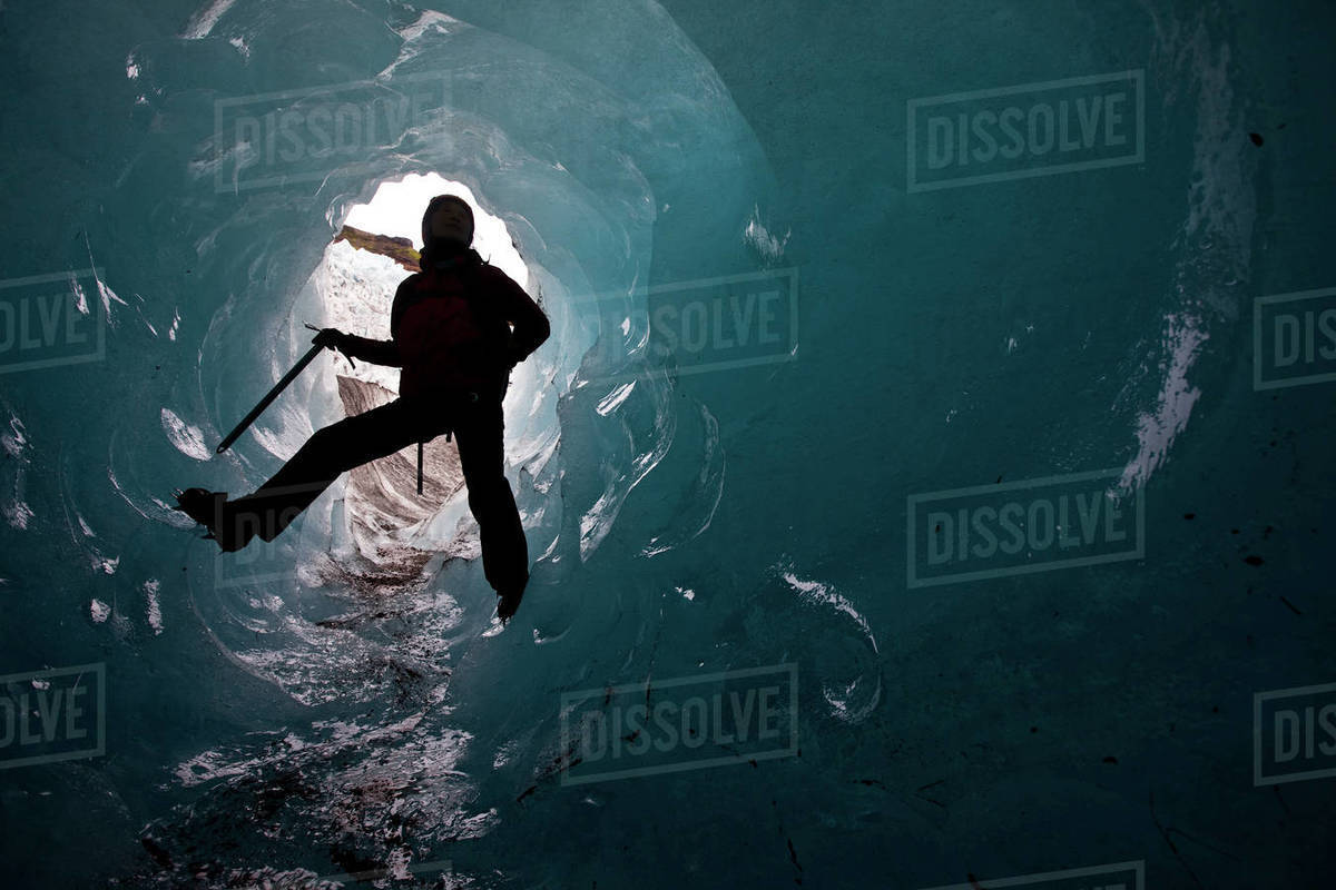 Woman exploring ice cave on Sólheimajökull glacier in south Iceland Royalty-free stock photo