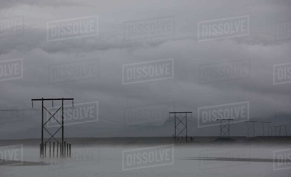 Pylons supporting power lines over the Skei√∞ar√°rsandur sander area Royalty-free stock photo