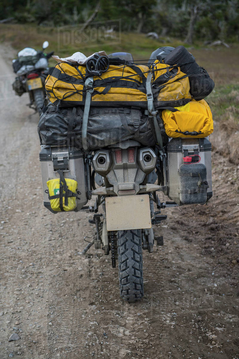 Heavily packed touring motorbike on dirt road, Tierra del Fuego Royalty-free stock photo