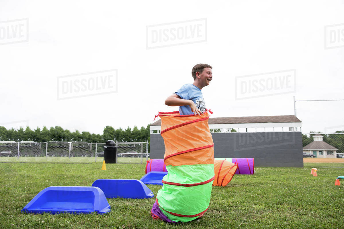 Smiling Tween Boy Plays Lawn Games During Field Day at School Royalty-free stock photo