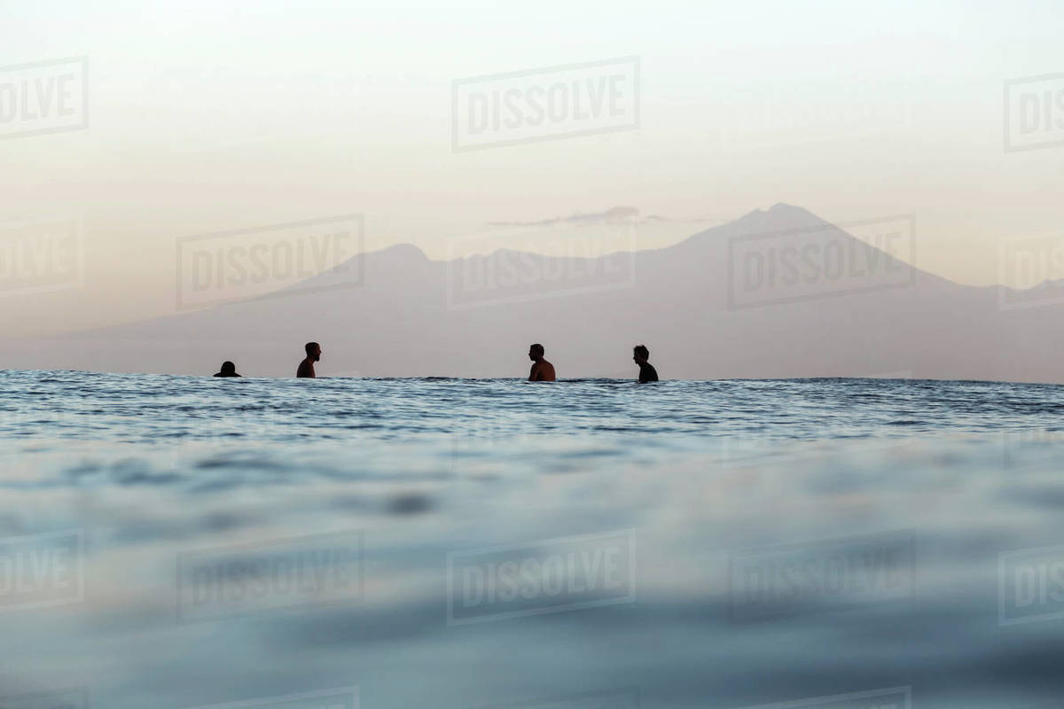 Surfers on surfboard on the sea waiting for a wave, Volcano Rinjani Royalty-free stock photo