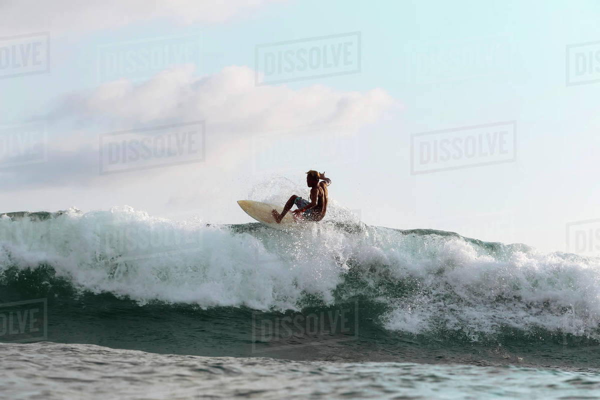 Surfer on a wave, Lombok, Indonesia Royalty-free stock photo