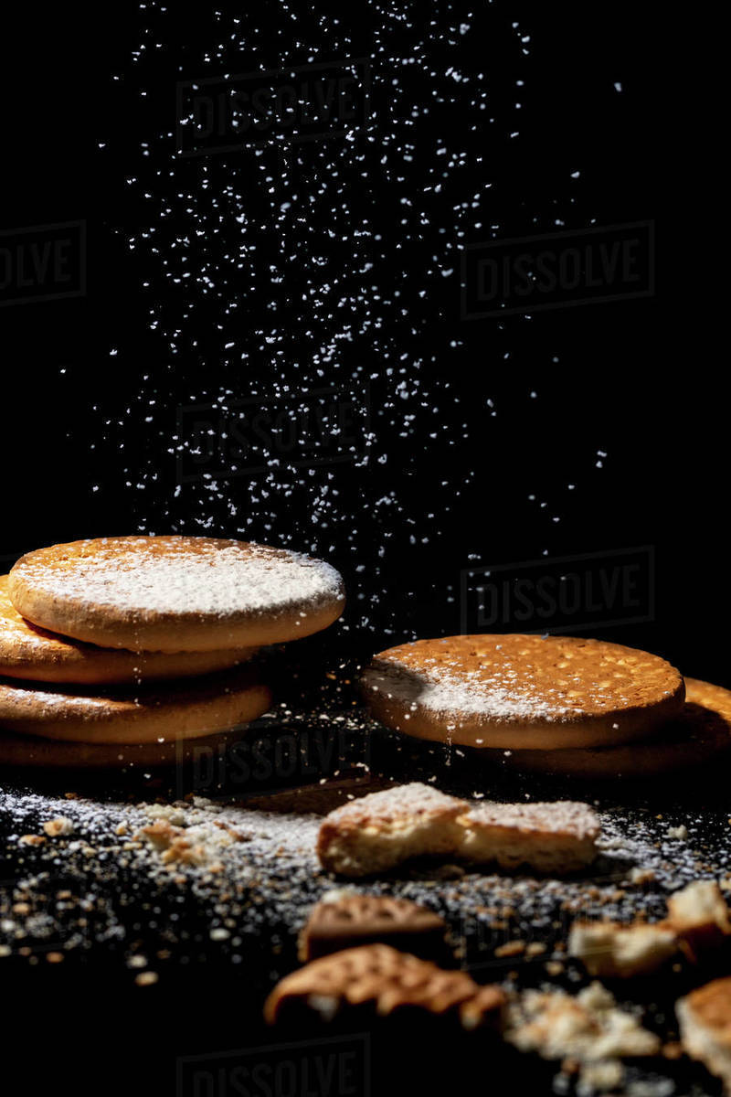 Artisan cookies piled on a black background with powdered sugar glass Royalty-free stock photo