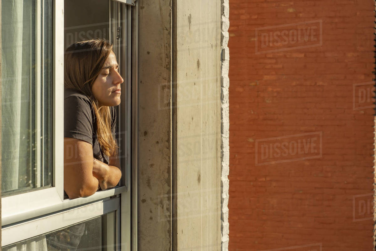 Woman in the windows during quarantine Royalty-free stock photo