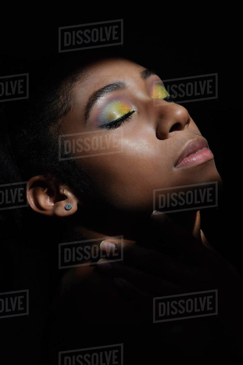 Interior chiaroscuro portrait of young black woman Royalty-free stock photo