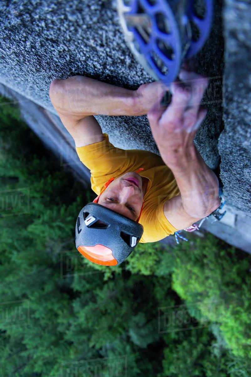 Man placing big cam in granite off-width crack lead climbing Squamish Royalty-free stock photo