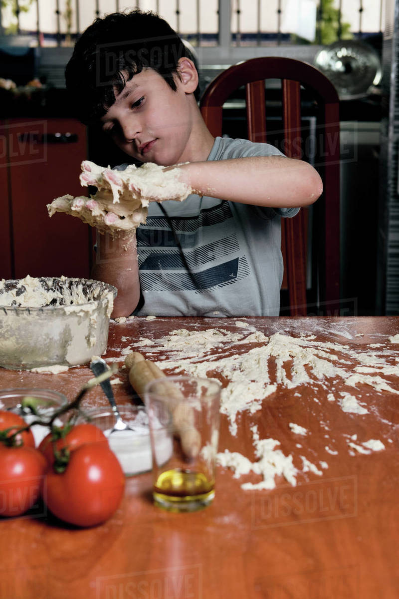 Young boy prepares pizza dough at home Royalty-free stock photo