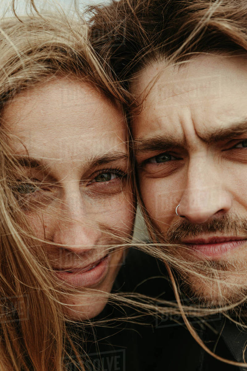 Up close of man and woman with eyes next to each other and windy hair Royalty-free stock photo