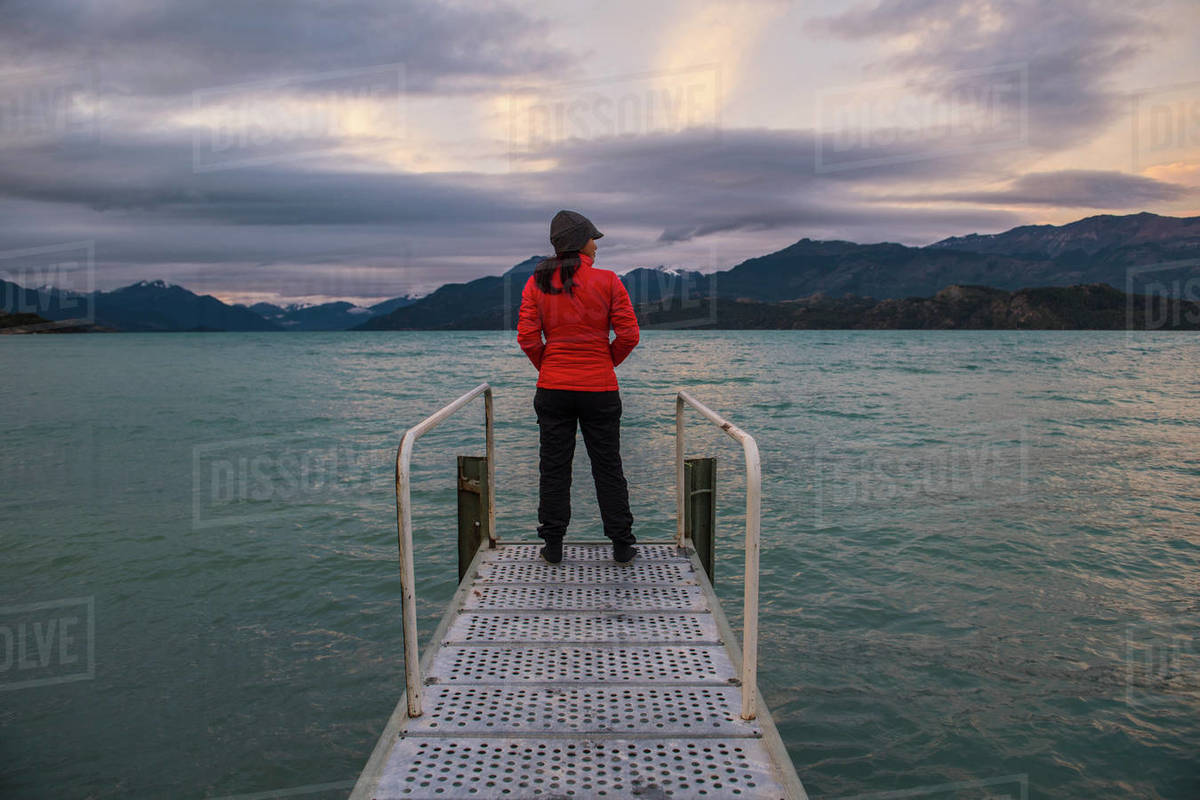 Woman standing on pier at Lago Rio Tranquillo, Carretera Austral Royalty-free stock photo
