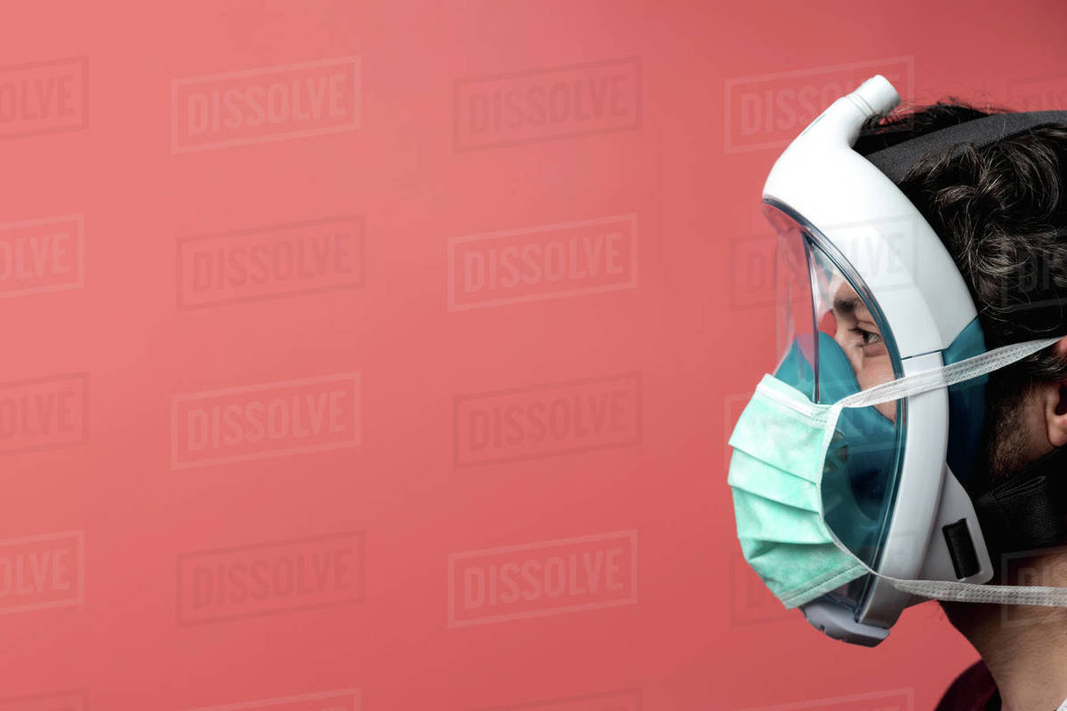 Man in profile with mask and underwater mask, Covid-19 protection Royalty-free stock photo