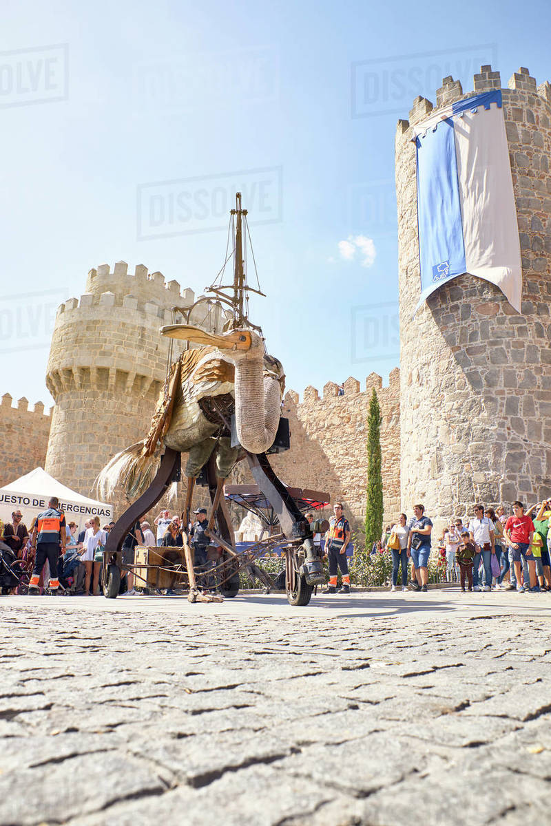 Giant wooden bird at a party next to the medieval wall of Avila. Avila, Spain Royalty-free stock photo