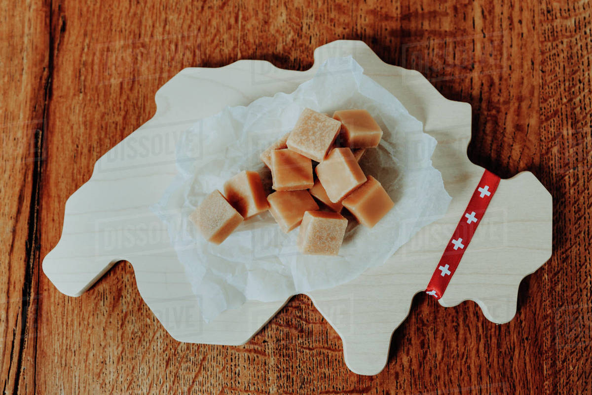 Swiss traditional milk caramel on the cutting board in the shape Royalty-free stock photo