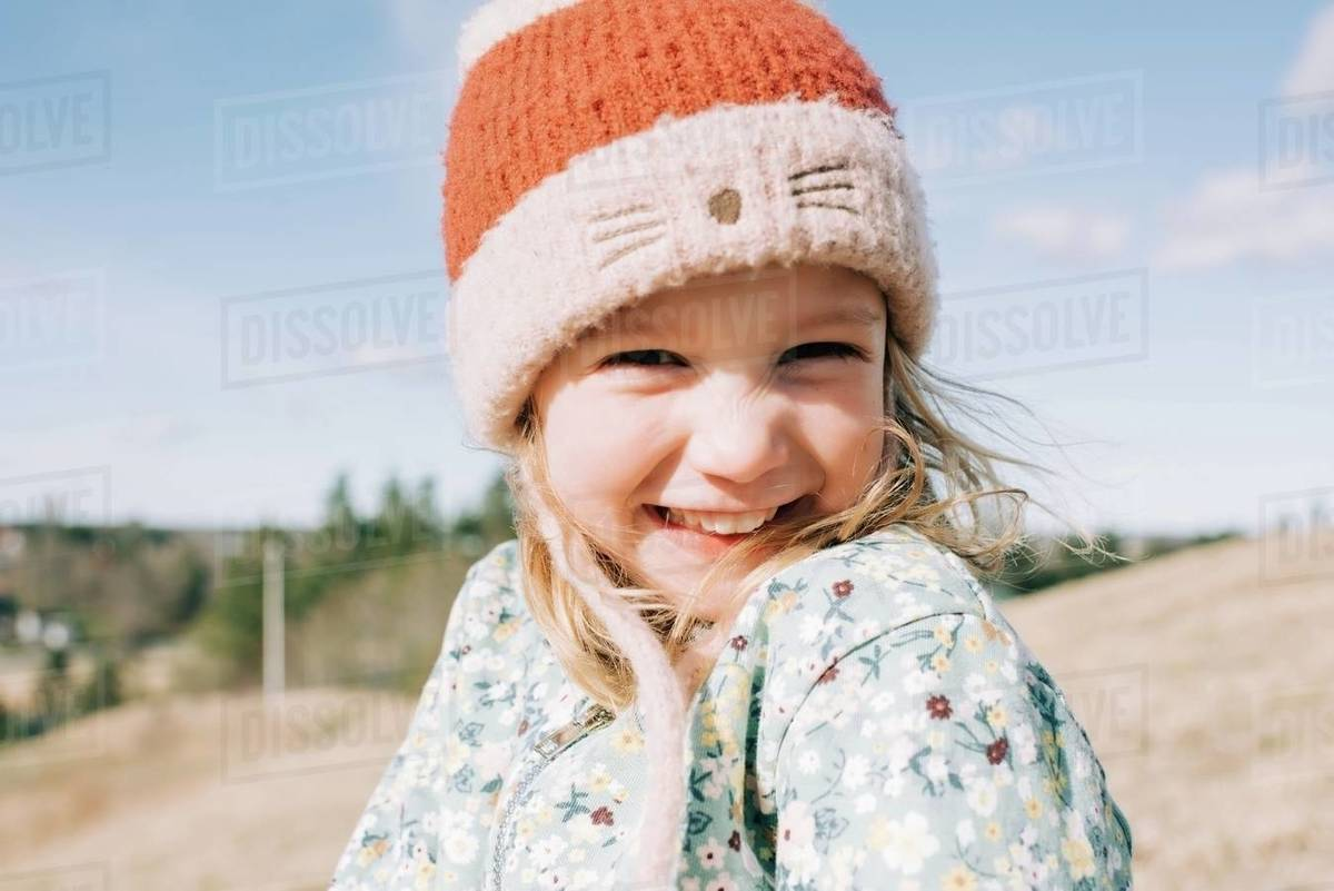 Portrait of a young girl smiling with her hair blowing in the wind Royalty-free stock photo