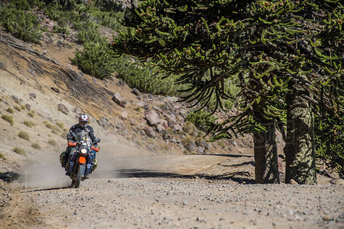 Man on touring motorbikes driving on gravel road in Argentina Royalty-free stock photo